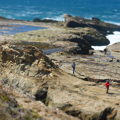photo of people exploring on cliffs