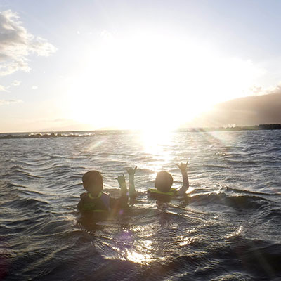 photo of 2 people in the water