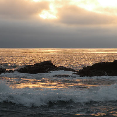 photo of a sunset over the beach in monterey bay