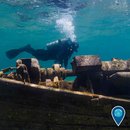 photo ofa diver and a shipwreck