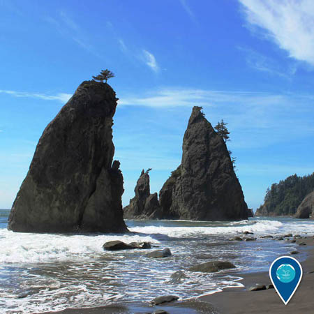 photo of a huge rocks and cliffs and a beach in olympic coast