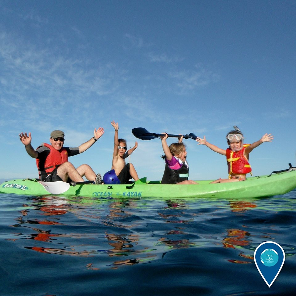 photo of kids and an adult in a kayak