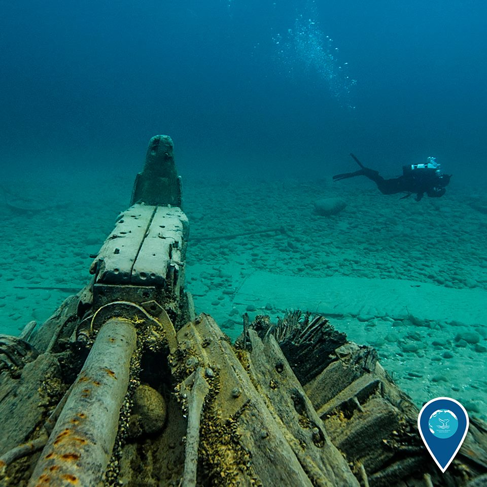 photo of a diver and shipwreck