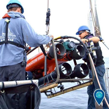 photo of scientists deploying an rov