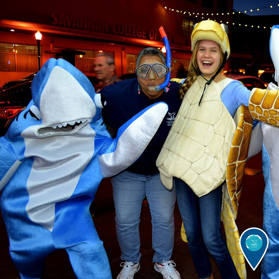 photo of volunteers in turtle and shark costumes