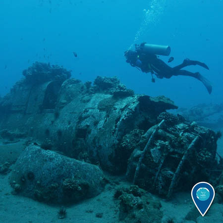 photo of diver and wreck