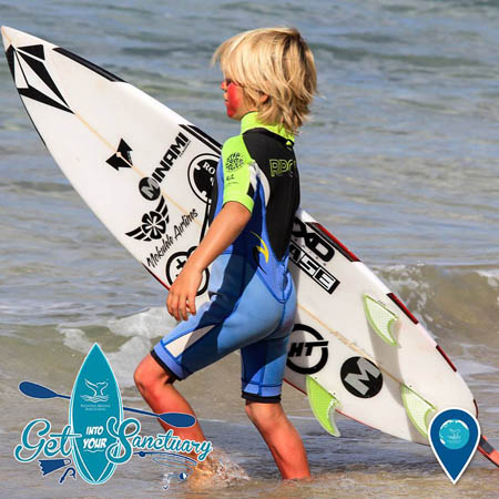 photo of a kid and a surfboard