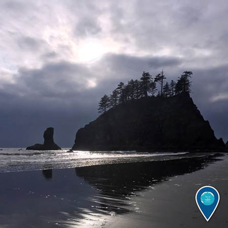 photo of a boulder in the water in Olympic Coast