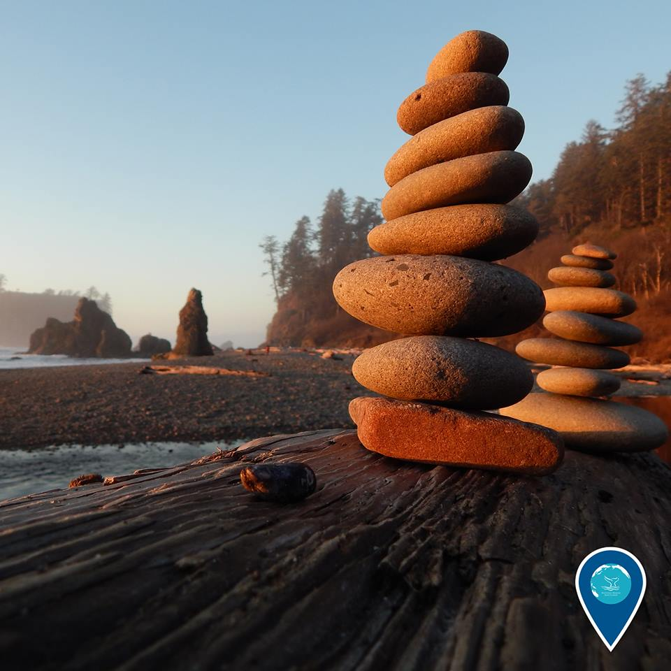 photo of rocks stacked on a beach