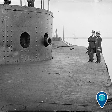 old photo of the uss monitor and 2 people