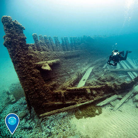 photo of a diver and a shipwreck