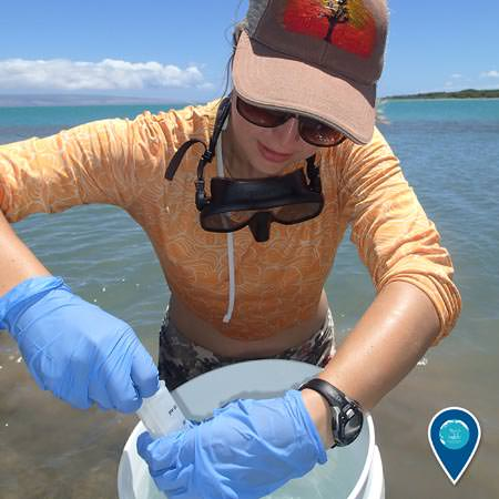 Emily Aiken collecting samples