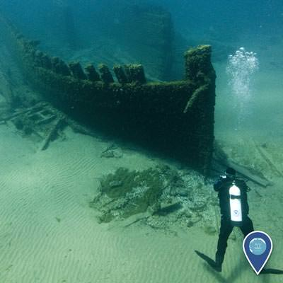 a diver looking at the bow of the wreck of the lucinda van valkenburg