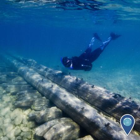 snorkeler swimming over the remains of the schooner american union