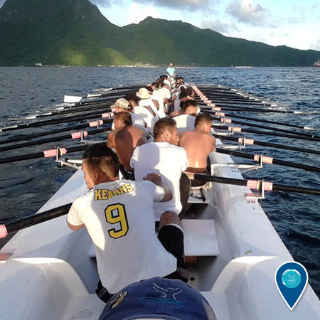 a rowing crew practicing in a longboat