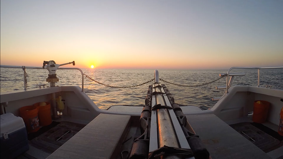 pview of a sunset from the stern of a boat