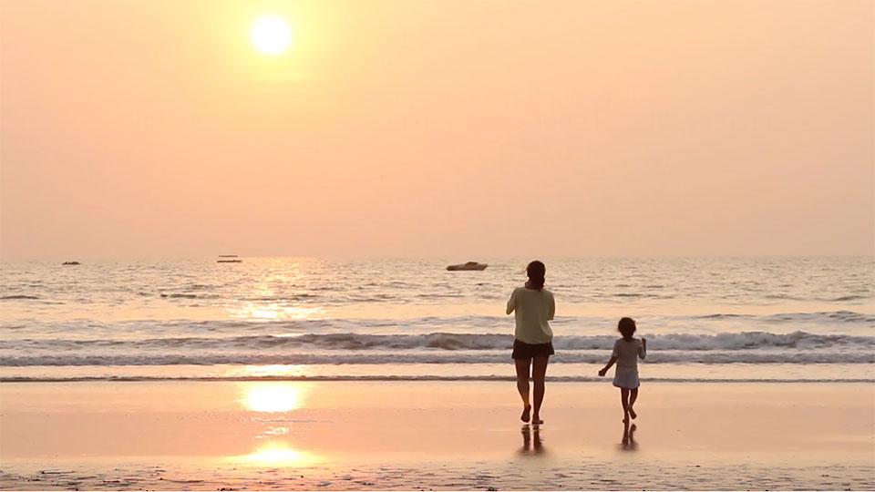 photo of a mother and daughter on the beach