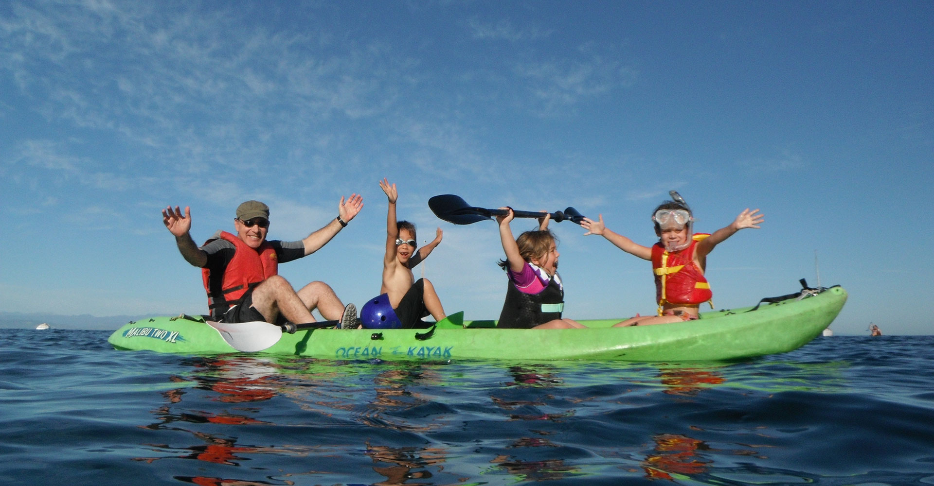 kids and an adult in a kayak
