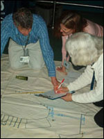Conference participants working with the the Monitor's Mock Shipwreck.