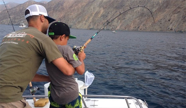 photo of father and son fishing