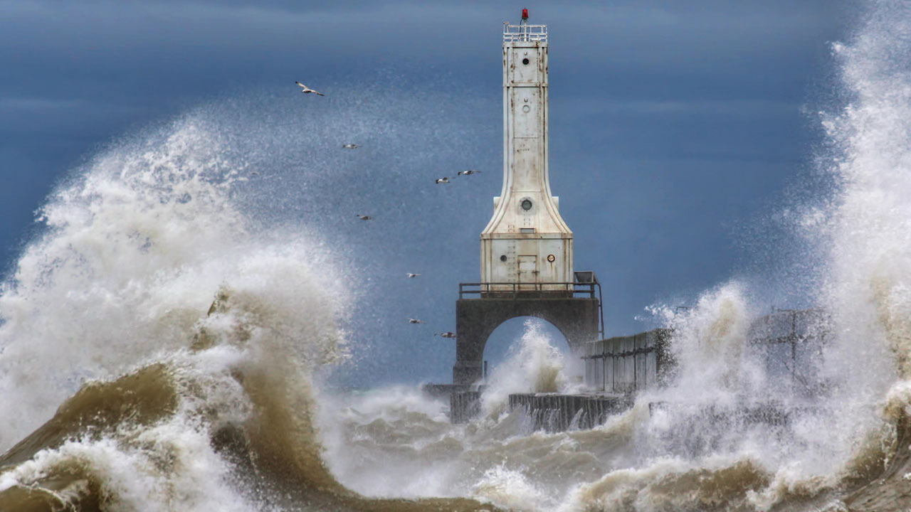 photo of lighthouse and waves