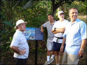 American Samoa Governor Togiola Tulafono, Sanctuary Program Pacific Regional Director Allen Tom, Sanctuary Program Director Dan Basta and Gerhard Kusaka from the White House's Center for Environmental Quality examine one of the newly installed sign along the Fagatele Bay Trail during their hike to the sanctuary. All were in American Samoa for the meeting of the U.S. Coral Reef Task force. View more photos of the trail and visitor center below.