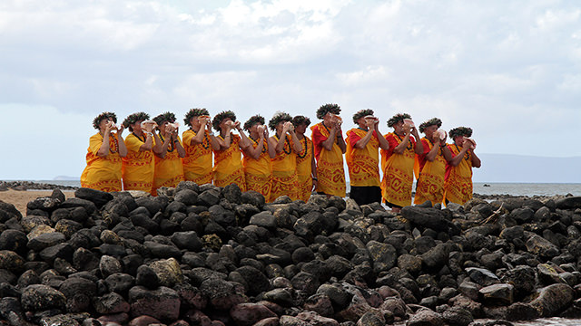 Local canoe club members lead a cultural protocol at Kalepolepo Beach Park in Kīhei, Maui.