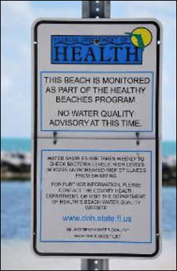 Figure 12. The Florida Department of Health posts swimming advisories at beaches throughout the Florida Keys. This sign indicates if it is advisable or not to swim due to water quality issues such as fecal coliform levels. (Photo: NOAA/FKNMS)