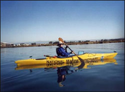 Caption: Volunteer docent with the TeamOCEAN kayaker outreach program. Photo: NOAA/MBNMS