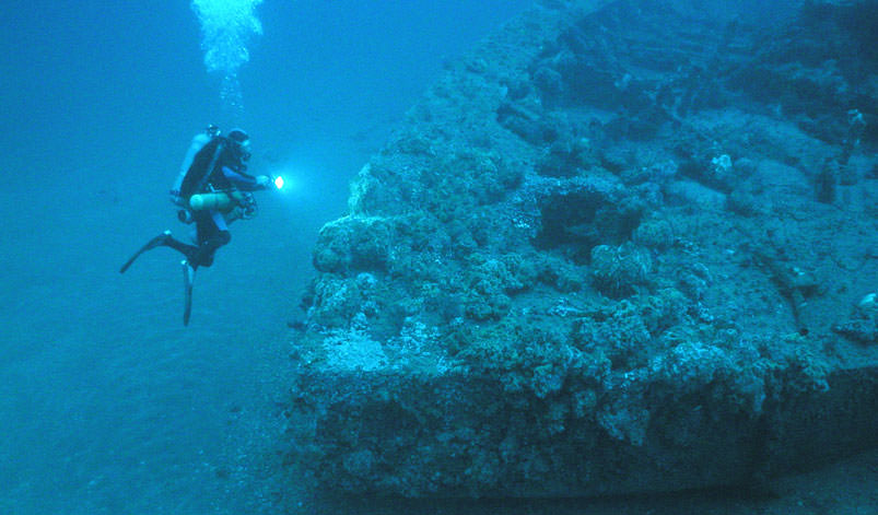 Photo of a diver and the uss monitor