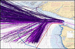 Figure 20. Track lines from large commercial vessels transiting the western Strait of Juan de Fuca in June 2007. Purple lines are tanker traffic. Darker lines are freighter traffic. The light blue line is the sanctuary boundary, and the red line marks the Area-To-Be-Avoided.