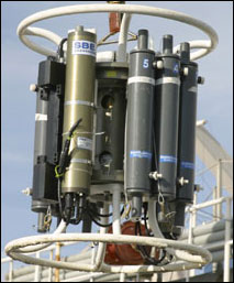 Water quality data is collected by lowering equipment into the ocean to sample a water column profile from the bottom to the surface. This rosette is a series of instruments on a metal frame that measures temperature, pressure, salinity, oxygen content, algae content and other factors, and features chambers to collect water samples at pre-determined depths. (Photo: Olympic Coast sanctuary)
