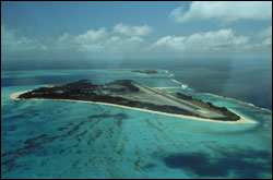 Figure 12. Sand (forefront) and Eastern Islands at Midway Atoll, the site of a U.S. naval air facility during the World War II and Cold War eras, before Midway was transferred to the U.S. Fish and Wildlife Service in 1996.