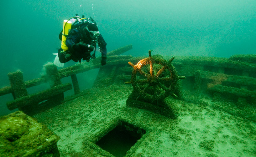 Photo of a diver and shipwreck in thunder bay
