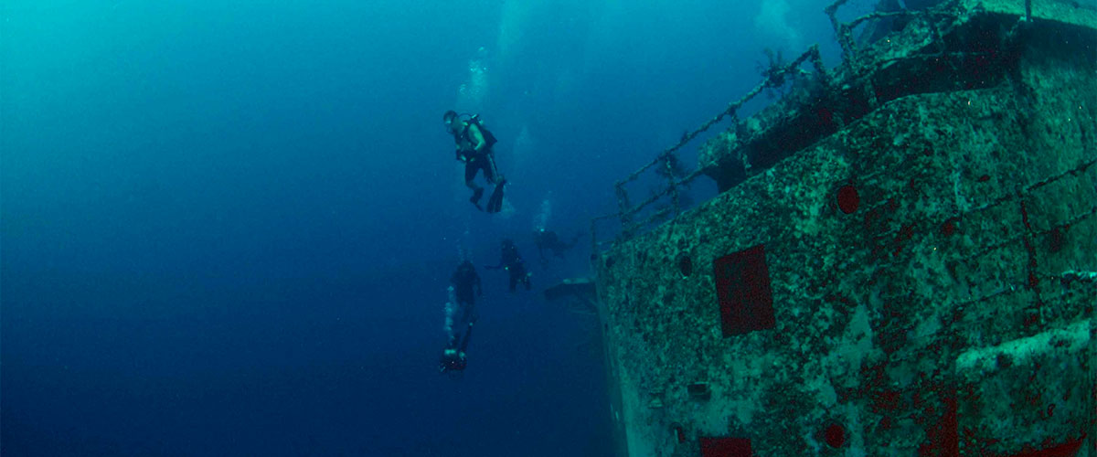 photo of a diver and the USS spiegel grove