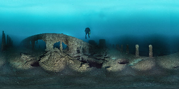 a diver swims over the remains of the steamer pewabic