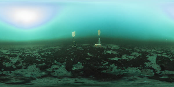 two sampling instruments situated atop large purple bacterial mats