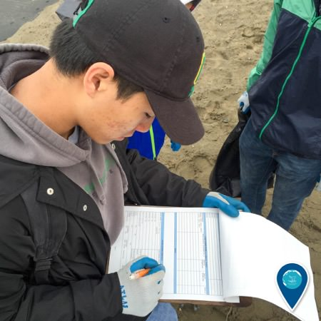 citizen scientist writing results on a clipboard