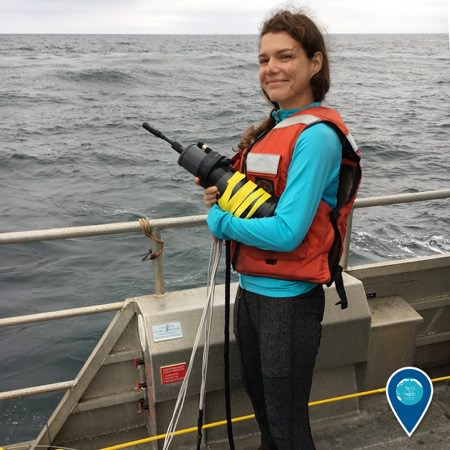 Michelle Modest holds an underwater hydrophone ready for deployment