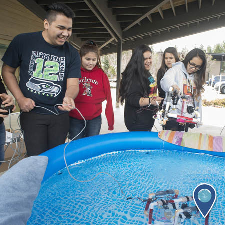students from the Quileute Tribal School pilot remotely operated vehicles that they built