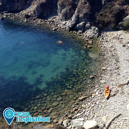 An overhead view of a kayak pulled out on shore in Gerstle Cove in Greater Farallones National Marine Sanctuary.