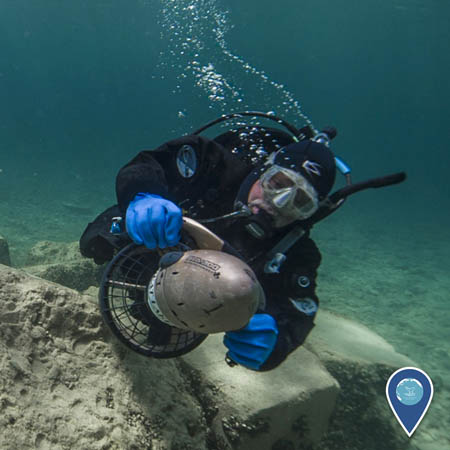 a noaa diver using a diver diver propulsion vehicle, or scooter