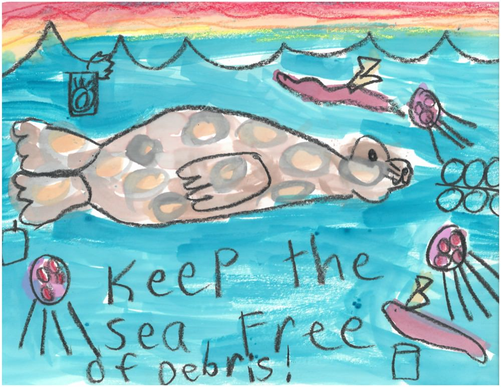first grader drawing depicting marine debris in the ocean and a seal swimming through the debris