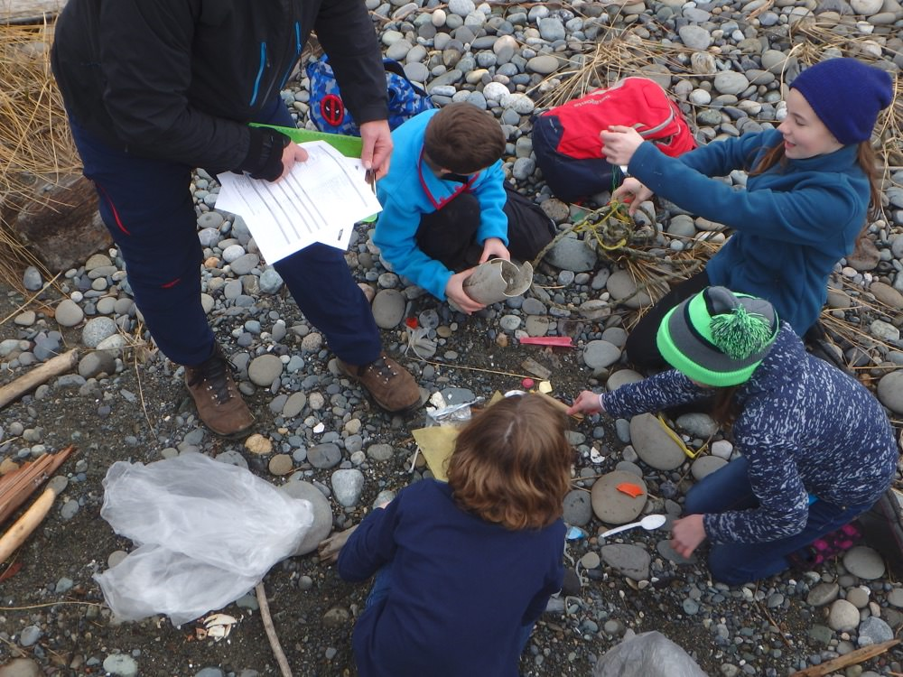 Students conduct marine debris monitoring on the beach