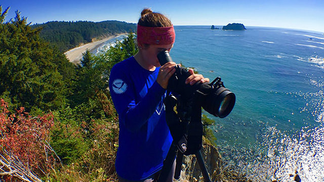jessica hale observing otters through a telescope