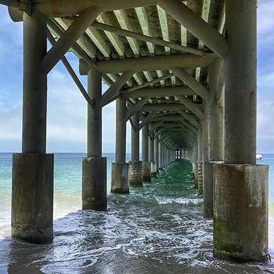 view of the ocean underneath a pier