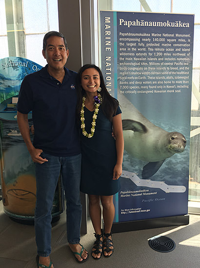 Kammie Dominique Tavares and another person standing next to a papahanaumokuakea rollout poster