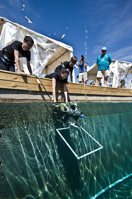 students launch a submersible into a water tank