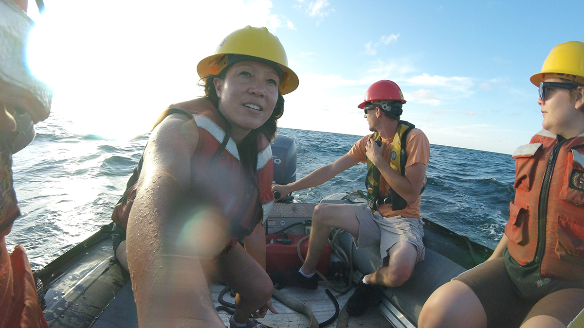 andrea kealoha and other researchers on a small boat