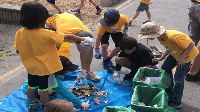 young students sorting trash